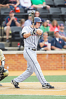 Joe McCarthy (31) of the Virginia Cavaliers follows through on his swing against the Wake Forest Demon Deacons at Wake Forest Baseball Park on May 17, 2014 in Winston-Salem, North Carolina.  The Demon Deacons defeated the Cavaliers 4-3.  (Brian Westerholt/Four Seam Images)