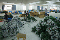 November 28, 2015, Yiwu China - Workers make Christmas trees inside Sinte An Christmas tree factory. The factory produces a variety of artificial trees for global export throughout the year.Photo by Dave Tacon / Sinopix