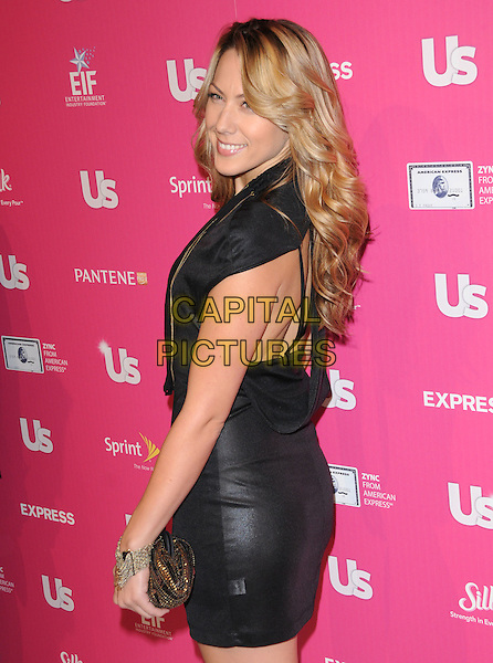 COLBIE CAILLAT.The Annual US Weekly Hot Hollywood Event held at The Colony in Hollywood, California, USA..November 18th, 2010.half length black sleeveless dress side clutch bag.CAP/RKE/DVS.©DVS/RockinExposures/Capital Pictures.
