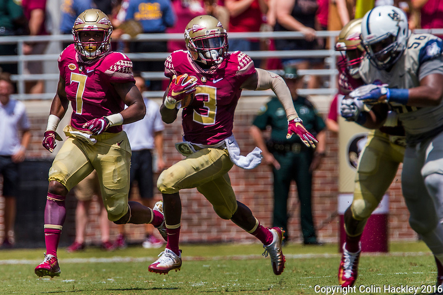 TALLAHASSEE, FLA 9/10/16-Florida State's Jesus &quot;Bobo&quot; Wilson, center, is joined by Ryan Green, left, as he starts his 89-yard punt return for the Seminole's fourth touchdown against Charleston Southern during first quarter action Saturday at Doak Campbell Stadium in Tallahassee. <br /> COLIN HACKLEY PHOTO