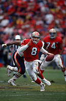 SAN FRANCISCO, CA:  Quarterback Steve Young of the San Francisco 49ers runs with the football during the NFC playoff game against the Chicago Bears at Candlestick Park in San Francisco, California on January 7, 1995. (Photo by Brad Mangin)