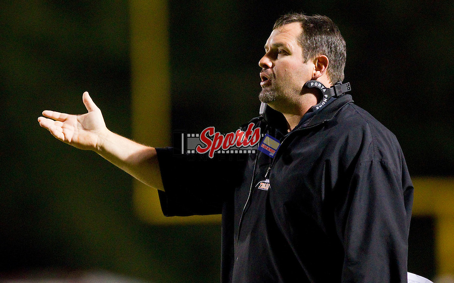 Northwest Cabarrus Trojans head coach Rich Williams questions a call during first half action against the J.M. Robinson Bulldogs at Trojan Stadium September 30, 2011, in Concord, North Carolina.  The Trojans defeated the Bulldogs 37-10.  (Brian Westerholt/Sports On Film)