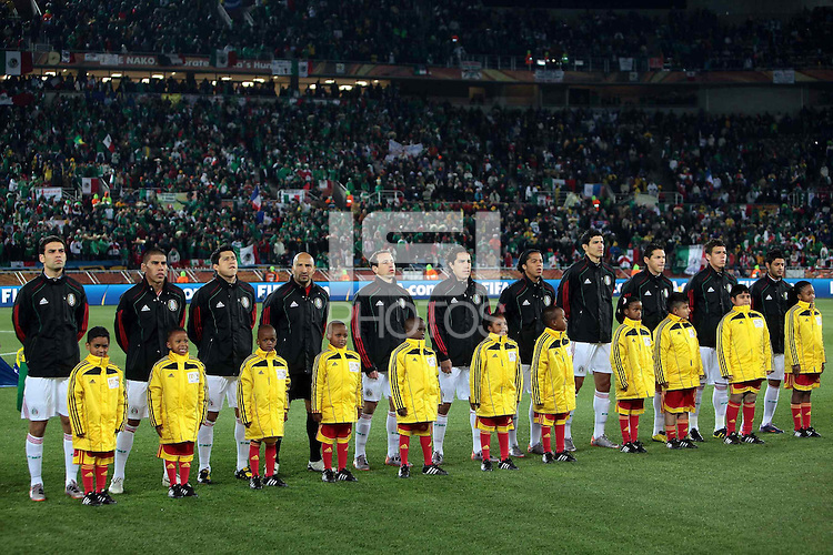 The Mexico team line up for the national anthems before the game against France