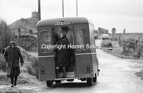 Local women shopping at the weekly mobile shop Callanish.  Callanish Standing Stones in distance. Isle of Lewis, Outer Hebrides, Highland and Islands Scotland 1974