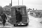 "Local women shopping at the weekly mobile shop Callanish.  Callanish Standing Stones in distance. Isle of Lewis and Harris,  Outer Hebrides, Highland and Islands Scotland 1974. On the side of the van its says ""M & A Cameron General Stores Roy Bridge"" Morag lived until she was 105 yrs died in 2015 and her twin brother Alasdair lived until he was in his eighties. They were well know business family in the community."