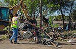 Antioch Code Enforcement and the Department of Public works were at the Fulton Shipyard to clean out the debrs left from a homeless encampment in Antioch, California, on Thursday, March 12, 2015.  Previous to the clean up residents of the encampment were given a 72 hour notice to vacate the area and were also provided with local support services information.  The sheriff's department also went to two nearby islands to give a 72 hour notice to the people living there.  Photo/Victoria Sheridan