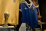 One of the displays featuring Maradona's 'Hand of God' shirt at the newly0opened National Football Museum in Manchester. The new museum, based in the futuristic Urbis building in the city centre of Manchester was set to open to the public on 6th July 2012. The National Football Museum, which was previously located in Preston, Lancashire, was expected to attract around 350,000 visitors each year.