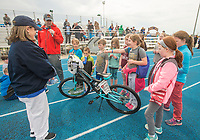 NWA Democrat-Gazette/BEN GOFF @NWABENGOFF<br /> Vickie Wright (left) with the Kiwanis Springdale Noon Club and Dan Skoff, meteorologist at KNWA, raffle off children's bicycles Saturday, April 21, 2018, during the Northwest Arkansas Kiwanis Clubs Fun Walk benefiting Arkansas Children's Northwest at the track at Springdale Har-Ber High. Thirteen Kiwanis clubs from Benton, Washington and Madison counties joined forces for the annual fundraiser.
