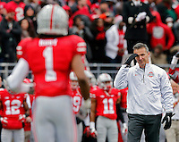 Ohio State Buckeyes head coach Urban Meyer salutes Ohio State Buckeyes cornerback Bradley Roby (1) during  senior day before the start of their game against Indiana Hoosiers at Ohio Stadium in Columbus, Ohio on November 23, 2013.  (Dispatch photo by Kyle Robertson)
