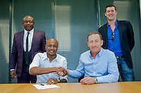Pictured: Andre Ayew (FRONT LEFT) with club chairman Huw Jenkins (FRONT RIGHT) at the Landore Training Ground, Swansea, UK. Thursday 10 June 2015<br /> Re: The latest Swansea transfer, Andre Ayew.