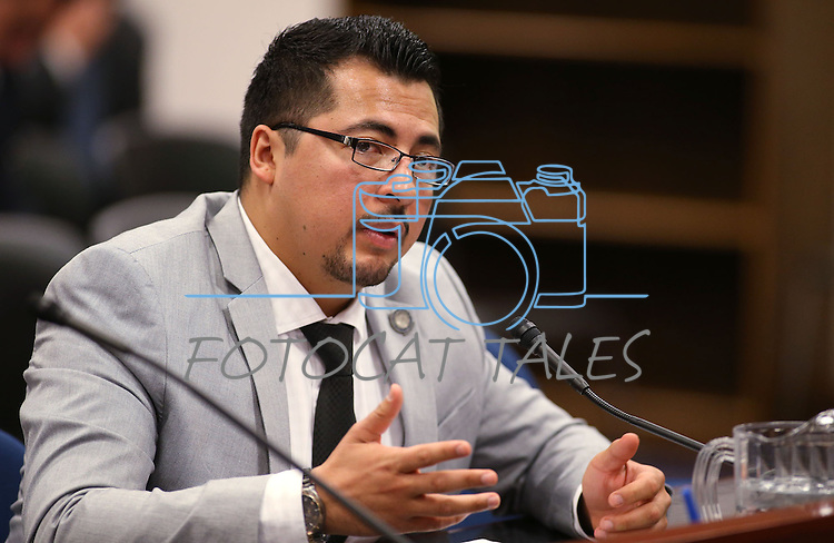 Nevada Assemblyman Edgar Flores, D-Las Vegas, works in committee at the Legislative Building in Carson City, Nev., on Monday, May 4, 2015.<br /> Photo by Cathleen Allison