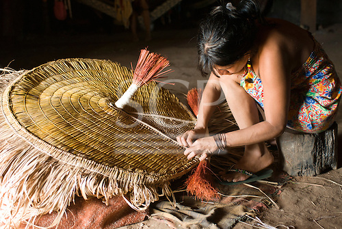Xingu Indigenous Park, Mato Grosso State, Brazil. Aldeia Yawalapiti. Tuira making a mask which is used in a healing ceremony.