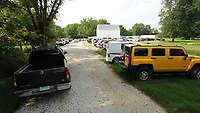 NWA Democrat-Gazette/ANDY SHUPE<br /> Cars are parked in a long line Wednesday, Aug. 7, 2019, during the first day of operations for The ReLeaf Center, a medical marijuana dispensary located at 9400 E. McNelly Rd. in Bentonville, the first of its kind in Northwest Arkansas.
