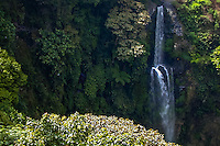 Indonesia, Java, Bandung. The Air Terjun Cerug Pengantin waterfall a few kilometers north of Bandung falls into a narrow valley.