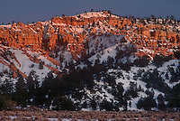 730750026a sunrise lights up the snow covered red rock formations in red rock canyon in the dixie national forest of north central utah