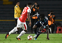 BOGOTA - COLOMBIA - 01 - 03 - 2018: John Pajoy (Izq.) jugador de Independiente Santa Fe disputa el balón con Juan Carlos Paredes (Der.) jugador de Emelec (ECU), durante partido entre Independiente Santa Fe (COL) y Emelec (ECU), de la fase de grupos, grupo 4, fecha 1 de la Copa Conmebol Libertadores 2018, jugado en el estadio Nemesio Camacho El Campin de la ciudad de Bogota. / John Pajoy (L) player of Independiente Santa Fe vies for the ball with Juan Carlos Paredes (R) player of Emelec (ECU), during a match between Independiente Santa Fe (COL) and Emelec (ECU), of the group stage, group 4, 1st date for the Conmebol Copa Libertadores 2018 at the Nemesio Camacho El Campin Stadium in Bogota city. Photo: VizzorImage  / Luis Ramirez / Staff.