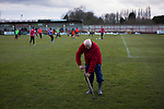 Witton Albion 1 Warrington Town 2, 26/12/2017. Wincham Park, Northern Premier League. A groundsman forking the pitch at Wincham Park, home of Witton Albion before their Northern Premier League premier division fixture with Warrington Town. Formed in 1887, the home team have played at their current ground since 1989 having relocated from the Central Ground in Northwich. With both team chasing play-off spots, the visitors emerged with a 2-1 victory, the winner being scored by Tony Gray in second half injury time, watched by a crowd of 503. Photo by Colin McPherson.