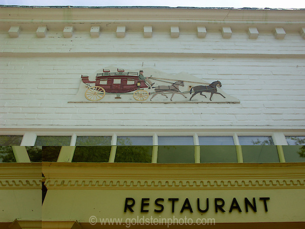 Restaurant sign. Architectural details of homes and other buildings in Middleburg, Loudoun County area of Virginia.