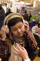 Trying out a pair of headphones.