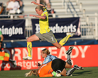 Beverly Goebel #6 of the Washington Freedom, playing in a special camouflage uniform crashes into Val Henderson #1 of the Philadelphia Independence as Sara Larrson #7 leaps over during a WPS match on military appreciation night at the Maryland Soccerplex in Boyds, Maryland on May 30 2010. Freedom won 2-1.