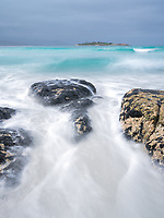 Bay of Fires is famous for its crystal-clear waters, white sandy beaches and orange lichen-covered granite boulders.  Bicheno is a beach town south of Bay of Fires.