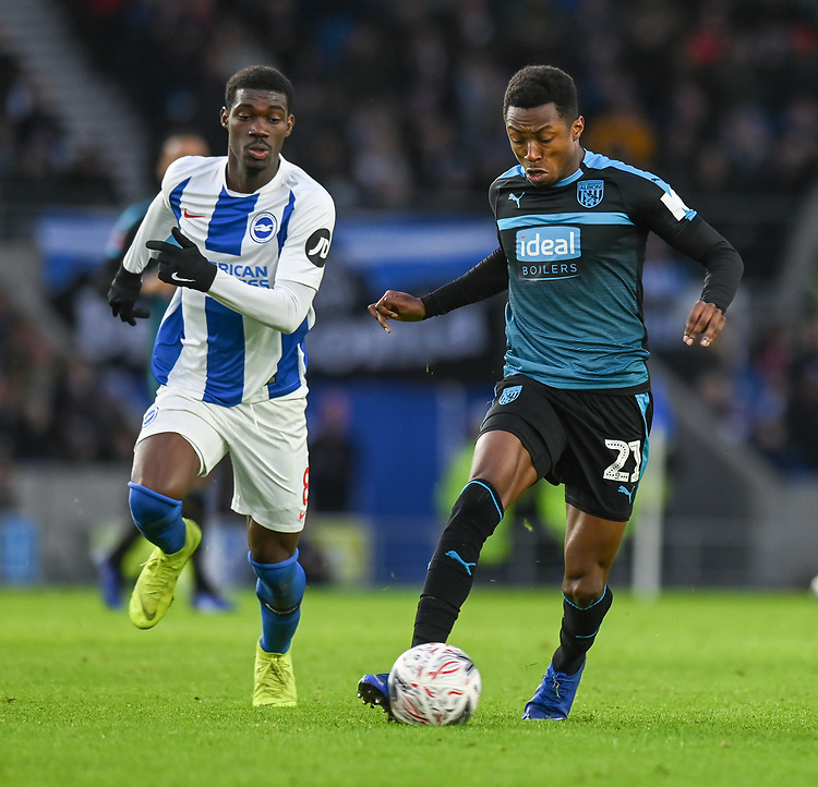 West Bromwich Albion's Kyle Edwards (right) under pressure from Brighton & Hove Albion's Yves Bissouma (left) <br /> <br /> Photographer David Horton/CameraSport<br /> <br /> Emirates FA Cup Fourth Round - Brighton and Hove Albion v West Bromwich Albion - Saturday 26th January 2019 - The Amex Stadium - Brighton<br />  <br /> World Copyright © 2019 CameraSport. All rights reserved. 43 Linden Ave. Countesthorpe. Leicester. England. LE8 5PG - Tel: +44 (0) 116 277 4147 - admin@camerasport.com - www.camerasport.com