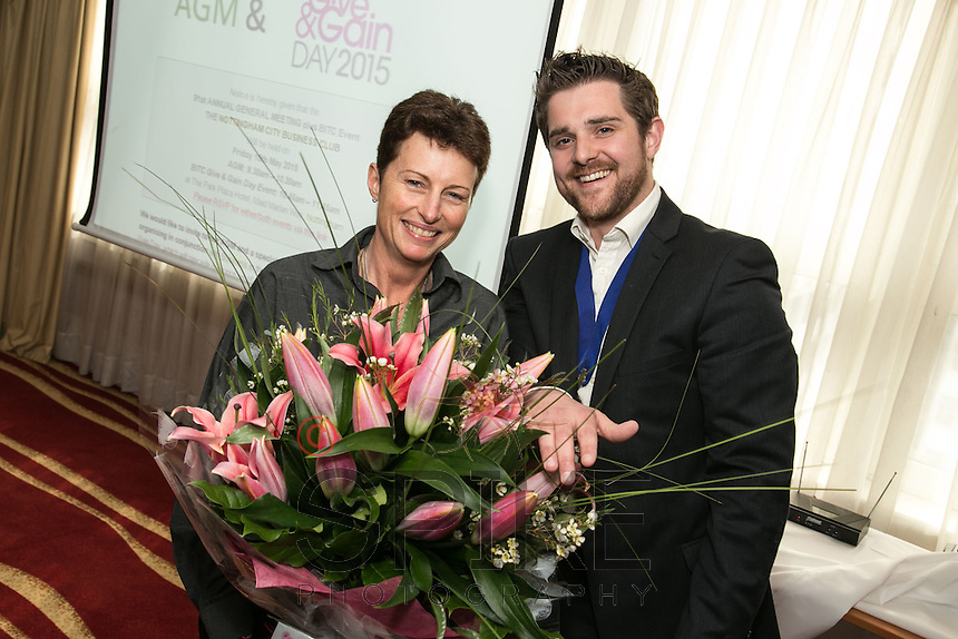Ami Coulson of Mazrs stepped dwn from her duties with the City Business Club and was presented with a bouquet by NCBC President Jonathan English