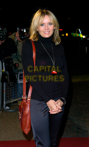 "DANIELLE BRENT.Arrivals - ""An Audience With Lionel Richie"" TV recording, ITV Television Centre, Aouth Bank, London, England, December 9th 2006..half length brown bag black polo neck top nekclace.CAP/CAN.©Can Nguyen/Capital Pictures"