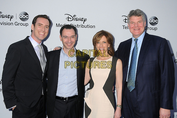 Michael Riley, Paul Lee, Anne Sweeney, Ben Pyne.Disney Media Networks International Upfronts 2013 held at Walt Disney Studios, Burbank, California, USA..May 19th, 2013.half length black white blue shirt tie suit dress .CAP/ADM/BP.©Byron Purvis/AdMedia/Capital Pictures