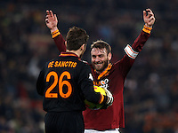 Calcio, quarti di finale di Coppa Italia: Roma vs Juventus. Roma, stadio Olimpico, 21 gennaio 2014.<br /> AS Roma goalkeeper Morgan De Sanctis, left, and midfielder Daniele De Rossi celebrate at the end of the Italian Cup round of eight final football match between AS Roma and Juventus, at Rome's Olympic stadium, 21 January 2014. AS Roma won 1-0.<br /> UPDATE IMAGES PRESS/Riccardo De Luca