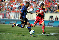 Manchester United forward Danny Welbeck (19) shoots the ball in front of Chicago Fire midfielder Logan Pause (12).  Manchester United defeated the Chicago Fire 3-1 at Soldier Field in Chicago, IL on July 23, 2011.