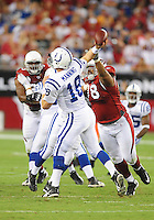 Sept. 27, 2009; Glendale, AZ, USA; Indianapolis Colts quarterback (18) Peyton Manning throws an interception in the first quarter against the Arizona Cardinals at University of Phoenix Stadium. Mandatory Credit: Mark J. Rebilas-