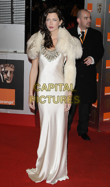 MARGOT STILLEY.Arrivals at the Orange British Academy Film Awards 2010 at the Royal Opera House, Covent Garden, London, England..February 21st, 2010.BAFTA BAFTAs full length white silk satin maxi dress fur wrap cream margo stilly .CAP/CAN.©Can Nguyen/Capital Pictures.