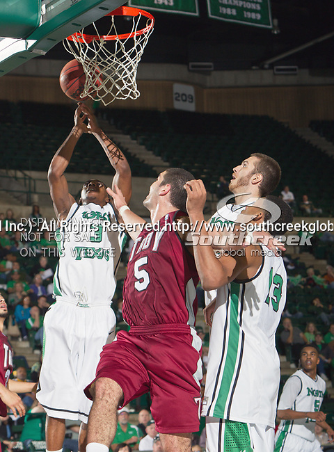 North Texas Mean Green guard Alzee Williams (3) and Troy Trojans guard/forward Justin Wright (5) in action during the game between the Troy Trojans and the University of North Texas Mean Green at the North Texas Coliseum,the Super Pit, in Denton, Texas. UNT defeats Troy 87 to 65.....