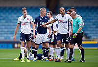 Bolton Wanderers' Reece Burke is shown a yellow card by Referee Andy Davies as Darren Pratley protests<br /> <br /> Photographer Ashley Western/CameraSport<br /> <br /> The EFL Sky Bet Championship - Millwall v Bolton Wanderers - Saturday August 12th 2017 - The Den - London<br /> <br /> World Copyright &not;&copy; 2017 CameraSport. All rights reserved. 43 Linden Ave. Countesthorpe. Leicester. England. LE8 5PG - Tel: +44 (0) 116 277 4147 - admin@camerasport.com - www.camerasport.com