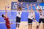 07 MAY 2016: Nicolas Szerszen (9) of Ohio State University goes for a kill as the Brigham Young University front line looks to defend the Division I Men's Volleyball Championship held at Rec Hall on the Penn State University campus in University Park, PA.  Ohio State defeated BYU 3-1 for the national title.  Ben Solomon/NCAA Photos