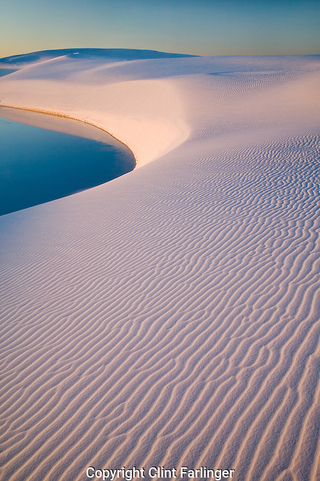 Gypsum sand dunes and seasonal pool, White Sands National Monument, New Mexico