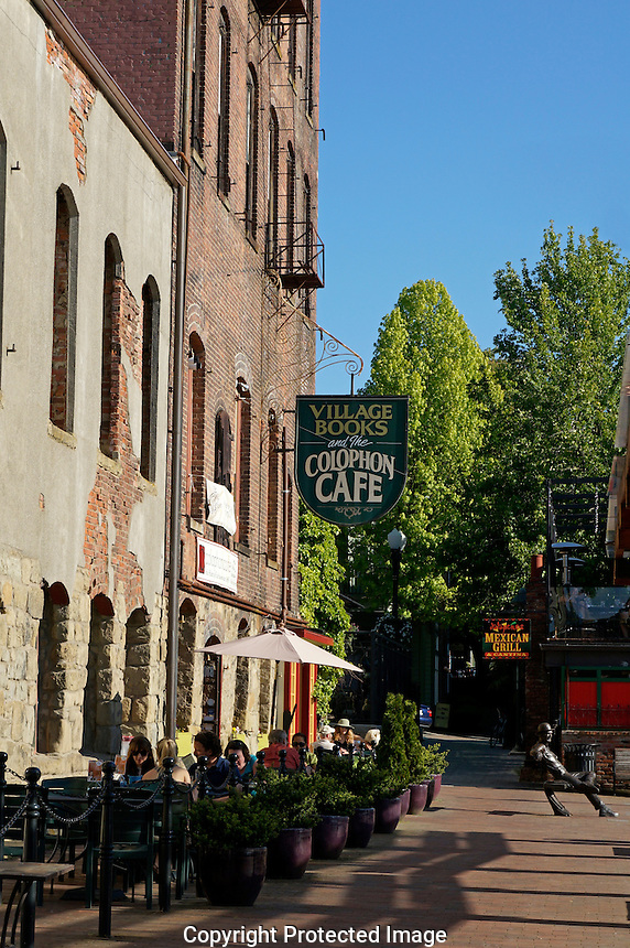 People sitting outdoors at the Colophon Cafe in the historical Fairhaven district of Bellingham, Washington state, USA