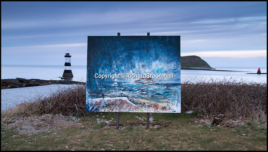 BNPS.co.uk (01202 558833)<br /> Pic: RichardBroomhall/BNPS<br /> <br /> Artist in Residence...Puffin Island from Penmon Priory.<br /> <br /> Artist Anthony Garratt is giving a whole new meaning to landscape painting - his incredible pieces aren't just of the landscape, they're in it too.<br /> <br /> The 35-year-old painter from Bristol has created four canvasses on the island of Anglesey as part of a new outdoor art installation and the paintings will remain in the exact spot they were painted until October.<br /> <br /> Mr Garratt spent several days on each of the giant 8ft-wide scenes, which are exposed to the elements and can be enjoyed by walkers as well as art fans. <br /> <br /> The landscapes had to be created on marine board - a thick marine plywood treated with sealant and epoxy, like a boat - rather than normal canvas, coated with five layers of varnish afterwards and mounted on bespoke steel frames to ensure they survive any harsh outdoor conditions.