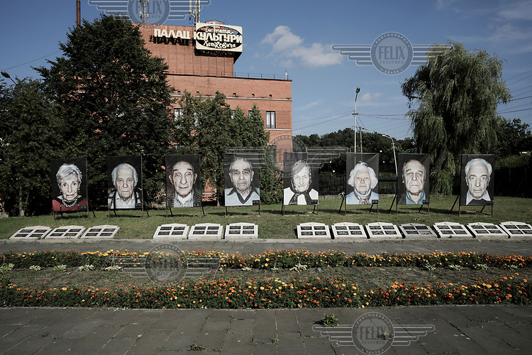 A memorial, in the city's former Jewish ghetto, to Ukrainian Jews murdered in WW2. A row of contemporary portraits of concentration camp survivors are displayed at the memorial.