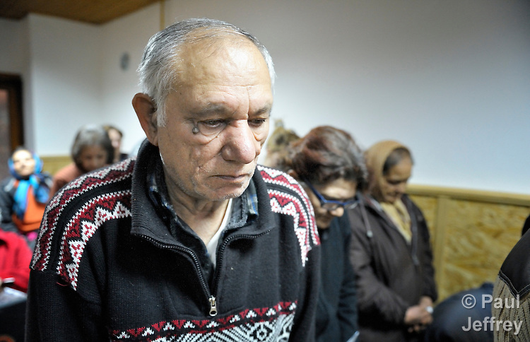 Karolj Nikolk prays with other worshippers during the service of a Roma congregation of The United Methodist Church in Srbobran, Serbia.