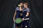 27 January 2017: Notre Dame's Eddy Covalschi (left) and Josh Hagar (right) confer during doubles. The University of North Carolina Tar Heels hosted the University of Notre Dame Fighting Irish at the Cone-enfield Tennis Center in Chapel Hill, North Carolina in the first round of the Intercollegiate Tennis Association Men's Indoor Team Championship. North Carolina won the match 4-0.