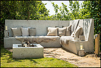 BNPS.co.uk (01202 558833)<br /> Pic: UniqueHomeStays/BNPS<br /> <br /> Concrete seating outside.<br /> <br /> Bomb proof hideaway - the perfect place to cement a relationship...<br /> <br /> A concrete carport has been transformed into a ultra cool luxury staycation bolt hole - with even its fireplace, kitchen worktops and bath made from concrete. <br /> <br /> The Hide is perfect for romantic weekends away or creative solo escapes but it will set the minimalist traveller back up to &pound;2,350 a week in peak season.<br /> <br /> Despite its slightly industrial appearance, it is actually a cosy rural retreat, surrounded by nature at the end of a winding country lane three miles from Perranporth beach in north Cornwall.<br /> <br /> Unique Home Stays used a bird hide as the inspiration with quirky stick-out windows that allow guests to stargaze from the bed and lighting designed to replicate the effect of sunlight through trees.