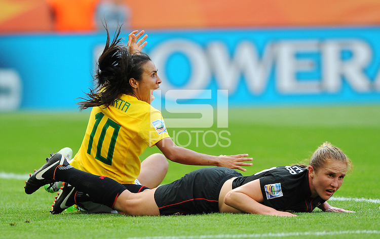 Marta (l) of team Brazil reacts after tackle from Rachel Buehler of team USA during the FIFA Women's World Cup at the FIFA Stadium in Dresden, Germany on July 10th, 2011.