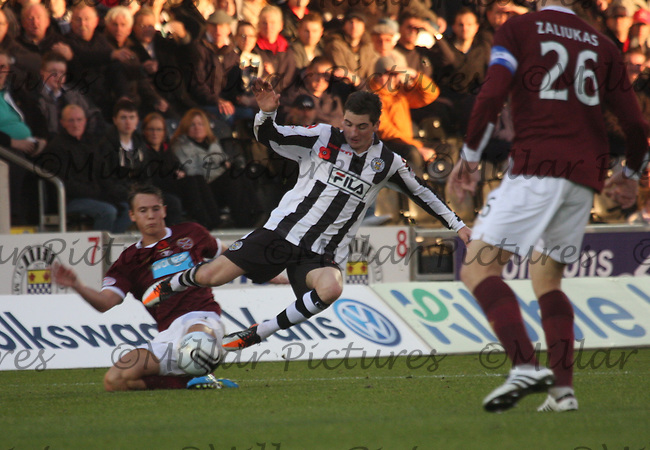 Kenny McLean tackled by Eggert Jonsson in the St Mirren v Heart of Midlothian Clydesdale Bank Scottish Premier League match played at New St Mirren Park, Paisley on 5.11.11.