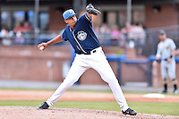 Asheville Tourists pitcher Salvador Justo (38) delivers a pitch during a game against the West Virginia Power at McCormick Field on June 25, 2016 in Asheville, North Carolina. The Tourists defeated the Power 8-4. (Tony Farlow/Four Seam Images)