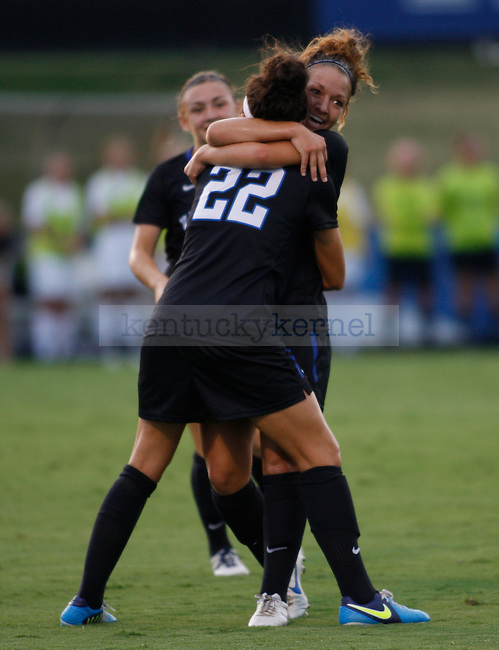 Freshman forward Cara Ledman (22) is hugged by junior forward Caitlin Landis after scoring a goal during the first half of the Women's Soccer game vs. UNC Greensboro at the UK Soccer Complex in Lexington, Ky., on Friday, August 31, 2012. Photo by Tessa Lighty | Staff