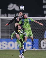 DC United midfielder Andrew Jacobson (8) goes up for the header.  The Seattle Sounders FC defeated DC United 2-1at RFK Stadium, Saturday September 12 , 2009.