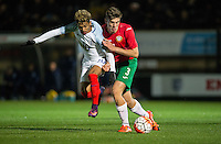 Andrea Hristov of Bulgaria U19 fouls Marcus Edwards (Tottenham Hotspur) of England U19 during the International friendly match between England U19 and Bulgaria U19 at Adams Park, High Wycombe, England on 10 October 2016. Photo by Andy Rowland.