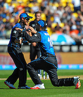 Brendon McCullum congratulates Daniel Vettori on his catch of Stuart Broad during the ICC Cricket World Cup one day pool match between the New Zealand Black Caps and England at Wellington Regional Stadium, Wellington, New Zealand on Friday, 20 February 2015. Photo: Dave Lintott / lintottphoto.co.nz